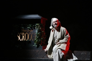 Gregor Paslawsky plays Ebenezer ScroogeHis tombstone is a prop as is the moving ivy that dresses it.